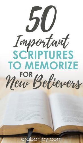 Open Bible on a table with an overlay that reads 50 important Scriptures to memorize for new believers