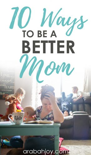 frazzled looking mom with hand on head and Bible open while holding a child and with other kids in the background