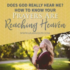 woman standing outside with eyes closed and hands folded in prayer #prayer #praying