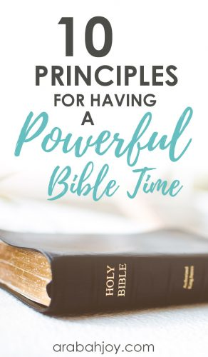 Black Bible sitting on a white table with an overlay that reads 10 principles for having a powerful Bible time