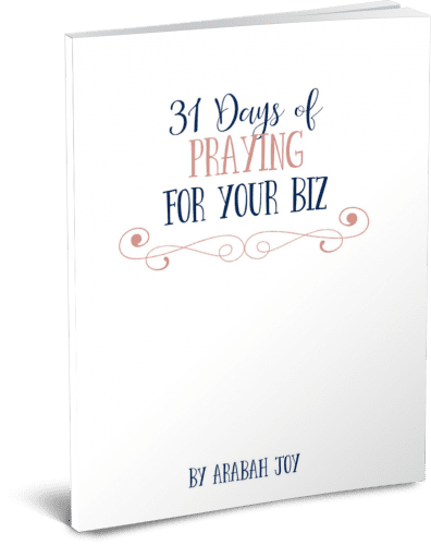 white cover of a book called 31 days of praying for your biz by Arabah Joy