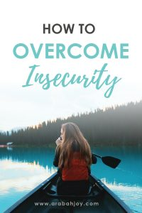 woman sitting in front of small boat with a paddle in hand and an overlay that reads how to overcome insecurity