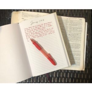 prayer journal and open bible